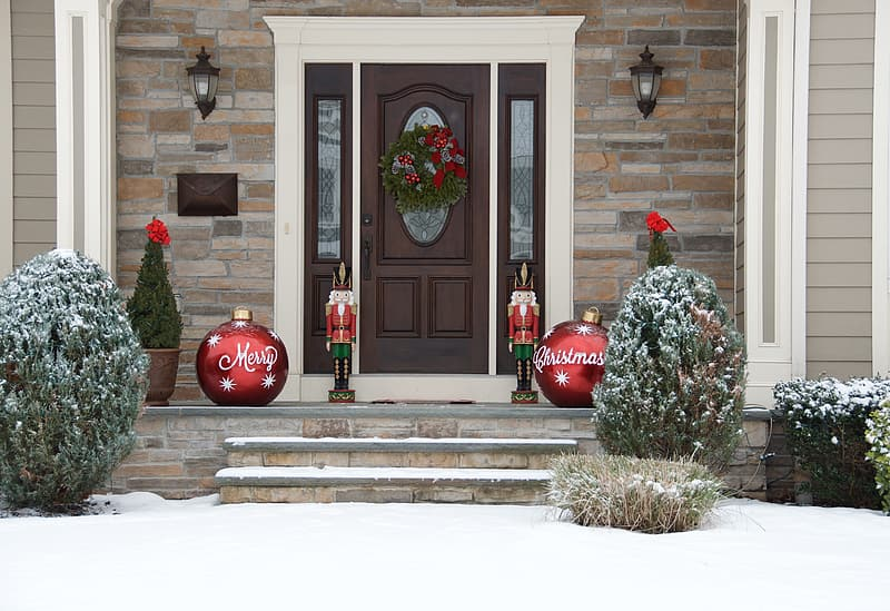 House with Christmas decorations outside the door