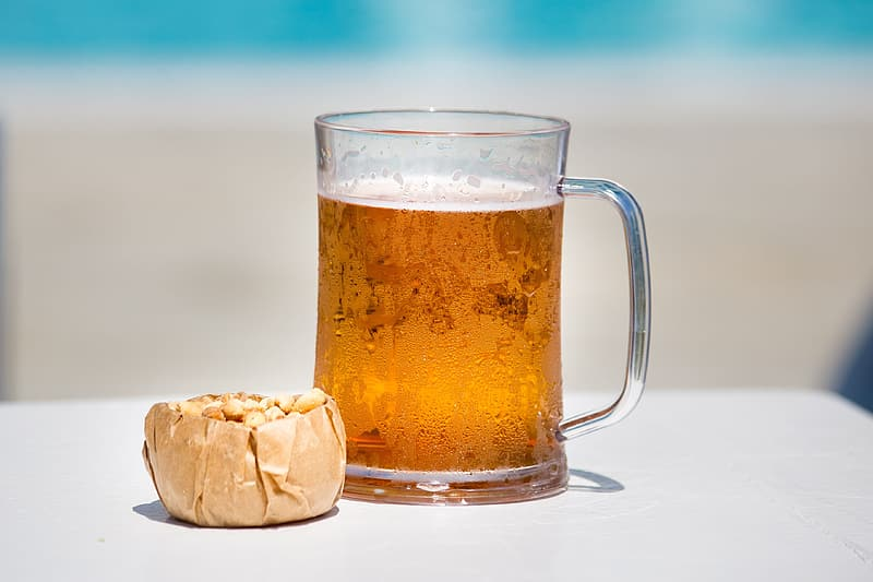 Clear glass mug with beer