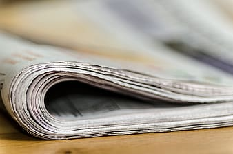 Selective focus photo of newspaper