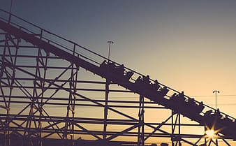 Silhouette of roller coaster during dusk