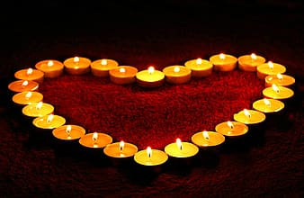 Heart formed lighted tealight candles