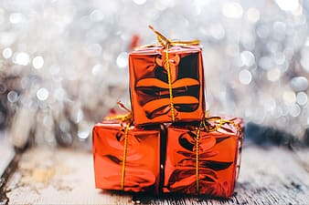 Three square red gift boxes