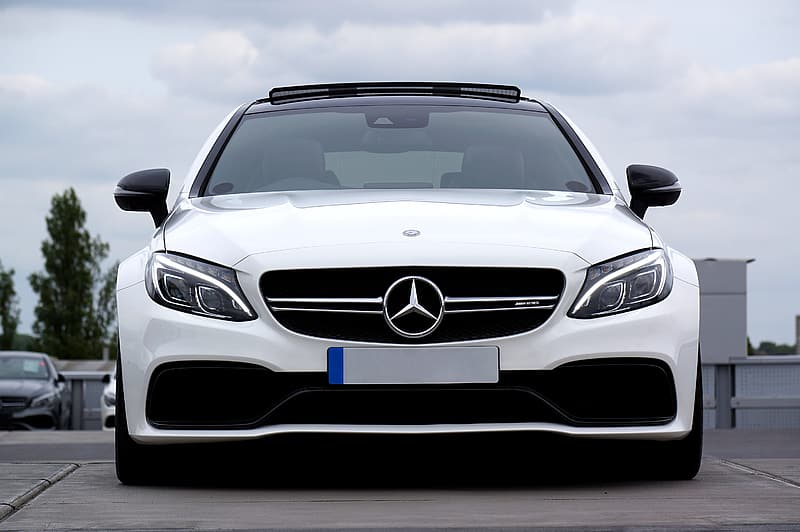 White Mercedes-Benz car parked on lot
