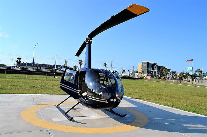 Black and gray helicopter on gray concrete ground during daytime