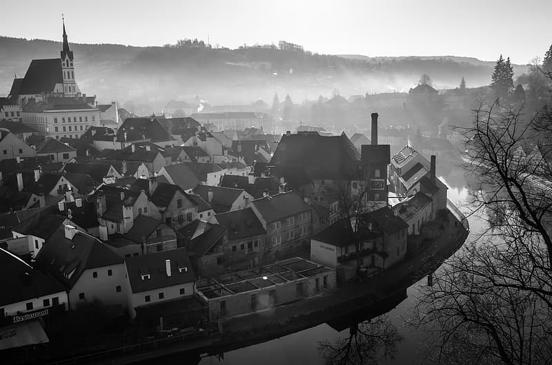 Grayscale photo of town during dusk
