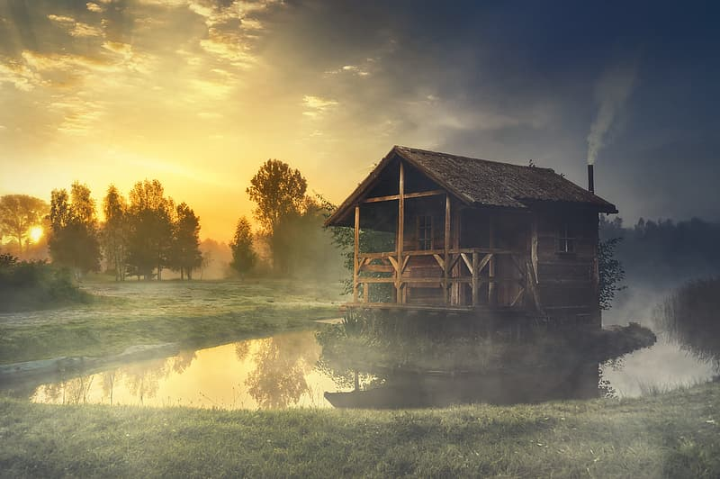 Brown wooden floating hut during sunset