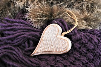 Brown heart shaped wooden ornament