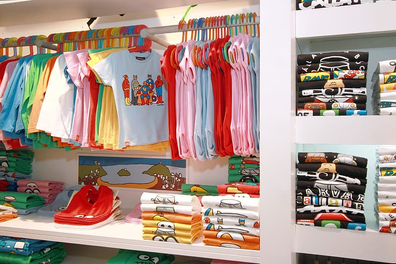 Toddler's clothing display on white shelf