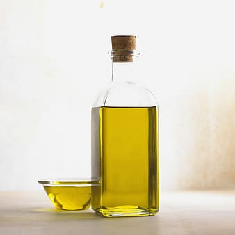 Bottle and cup of olive oil