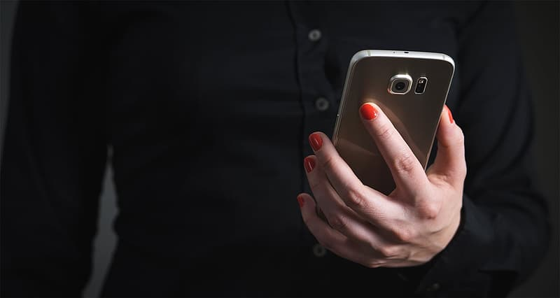 Person holding gold Samsung smartphone