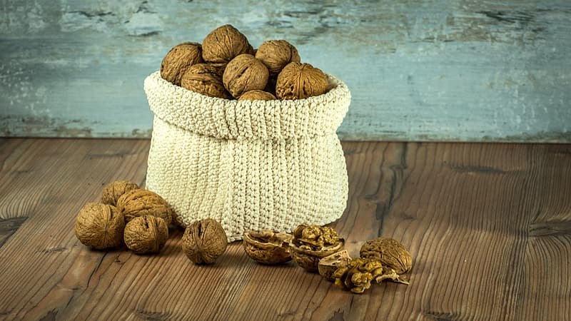 Bunch of nuts in knitted basket
