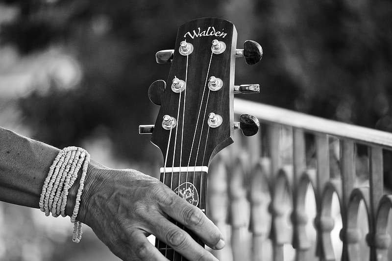 Person playing guitar in grayscale photography   Pikrepo