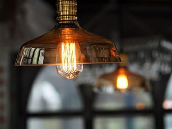 Clear bulb with amber glass lampshade
