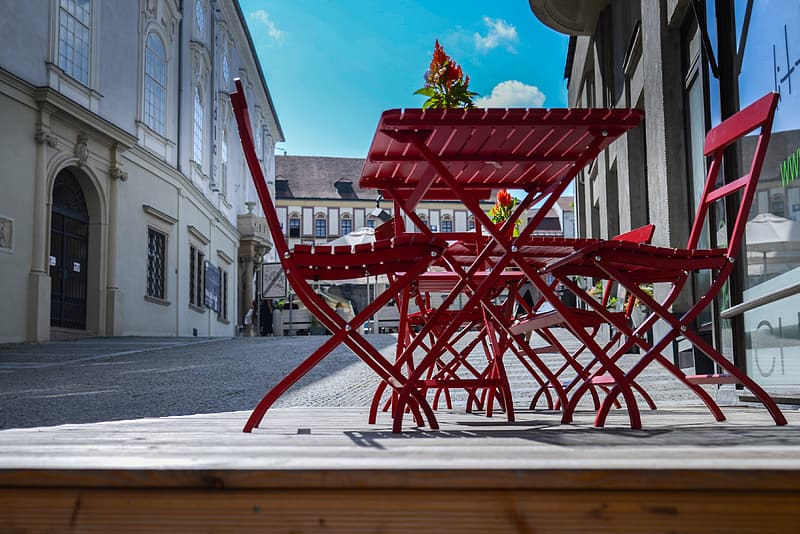 Red wooden folding patio table and chairs