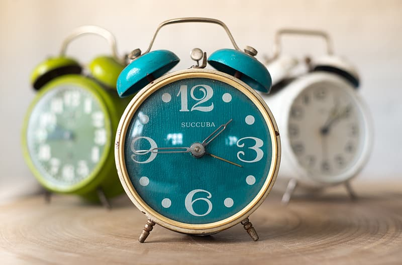 Three assorted-color twin bell alarm clocks