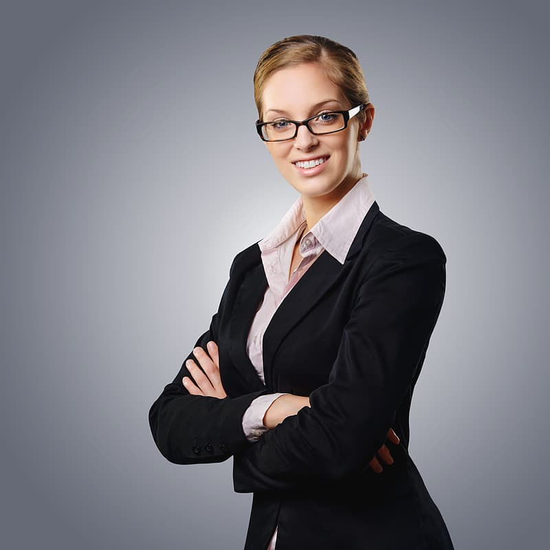 Woman wearing black blazer and beige dress shirt