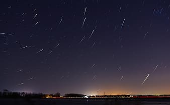 Star trails over field