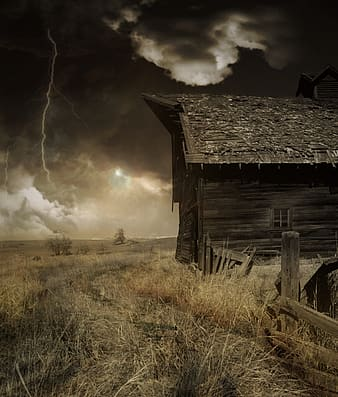 Storm approaching on green field with barn during daytime