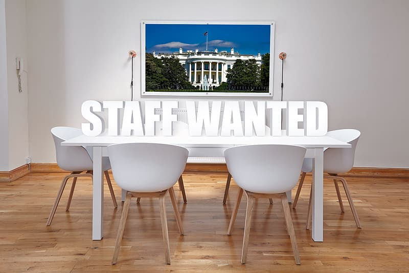Staff Wanted above table advertisement