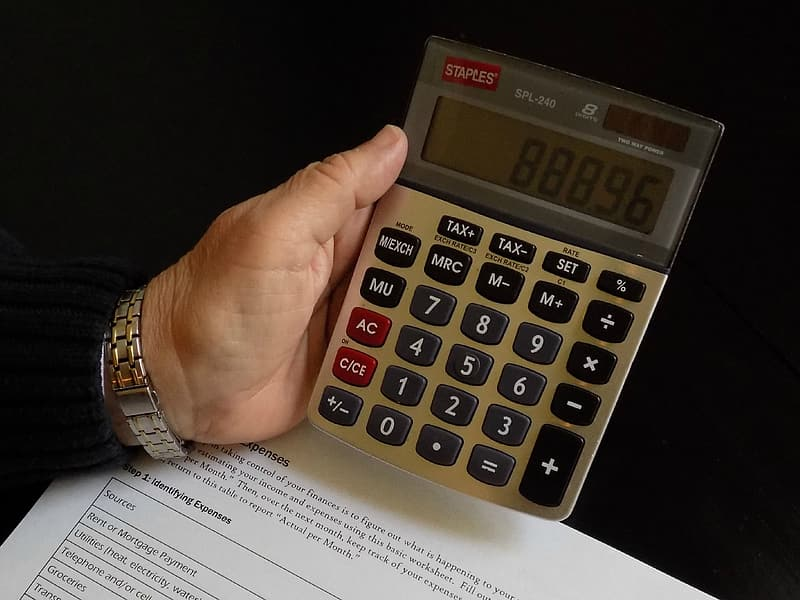 Person holding calculator set at 88896