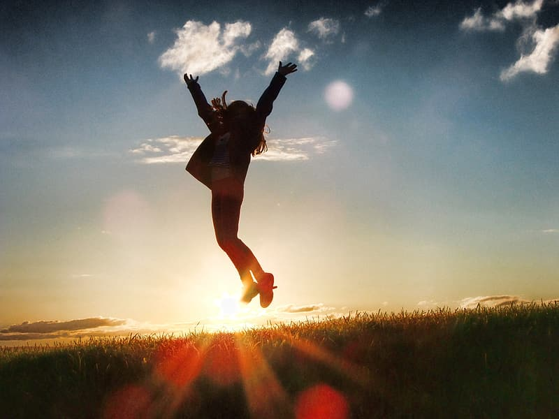 Silhouette photo of jumping girl