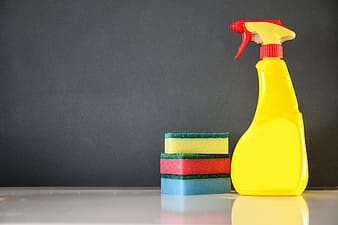 Yellow and red spray bottle