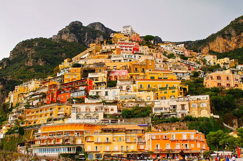 Assorted-color houses on top of mountain at daytime