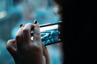 Selective focus photography of person taking picture