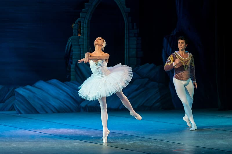 Woman dancing ballet on stage