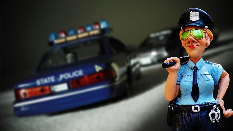 Police woman with car toy