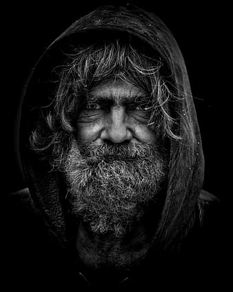 Grayscale macro photograph of man in hoodie
