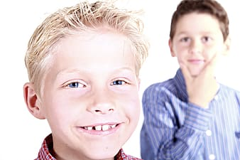 Two boy wearing red and blue striped dress shirts