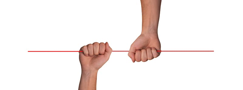 Person holding red plastic stick