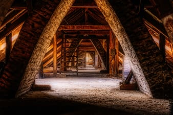 Brown wooden tunnel with white snow