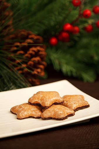 Star cookies on white plate selective-focus photography