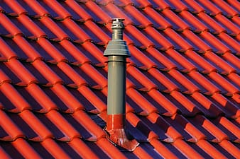 Gray and red tube pipe on roof