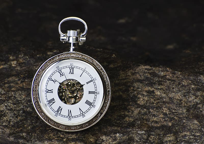 Selective focus photography of silver-colored pocket watch