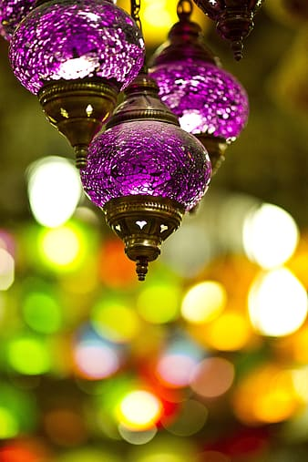 Focus photography of three purple hanging decor with bokeh background