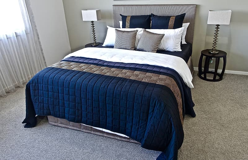 Blue mattress and gray bed frame