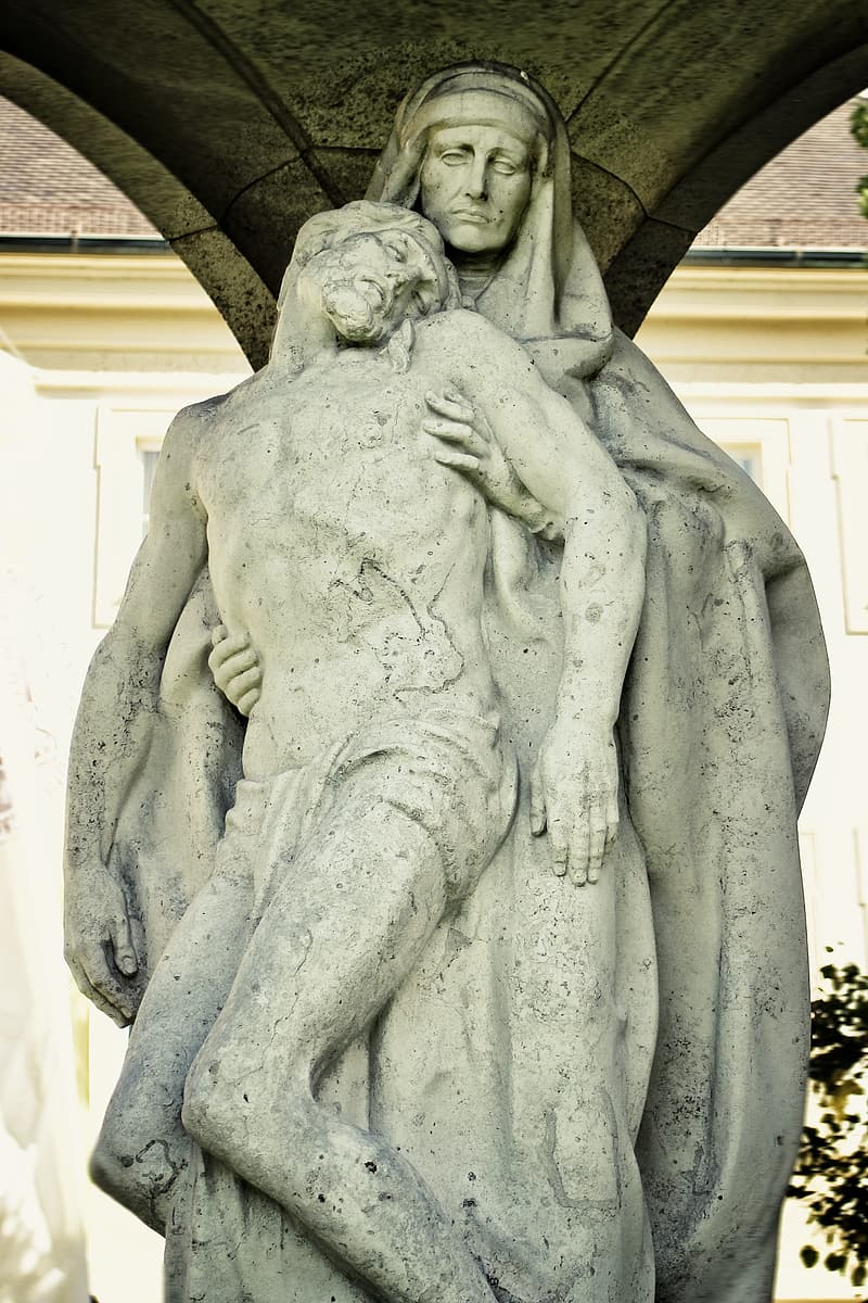 Woman holding her head statue
