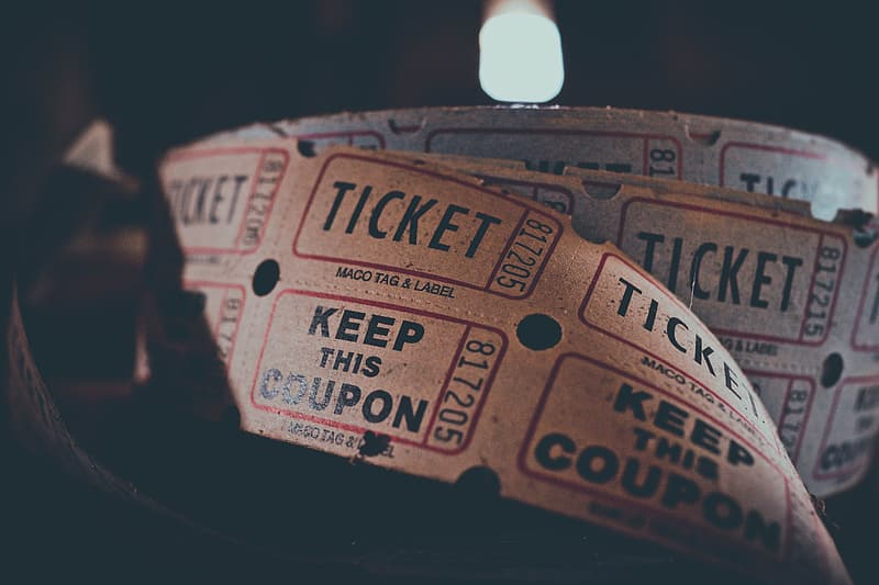 Close up photography of ticket coupons