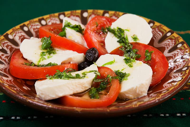 White cheese and tomato slices on plate