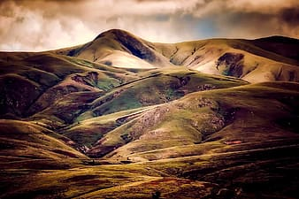 Green and brown mountain photo
