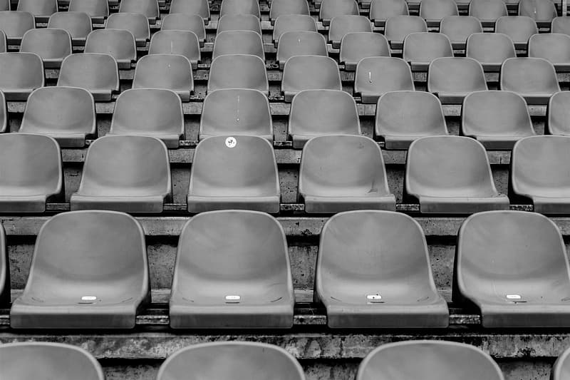 Grayscale photography of gang chairs