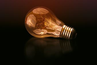 Light bulb on black surface