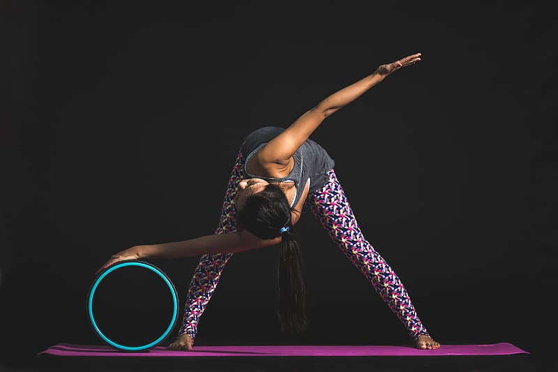 Person holding ball stretching