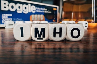 Imho cube letters on wooden surface