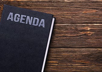 Agenda book on brown wooden surface