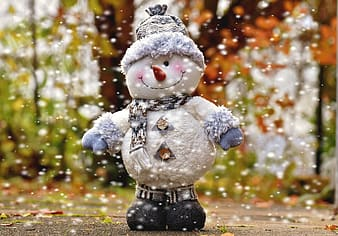 Snowman standing in middle of street
