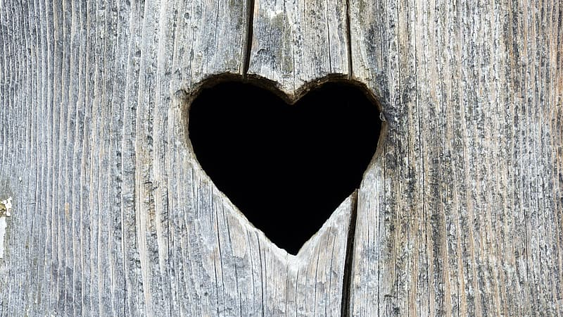 Gray wooden plank with heart hole